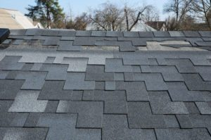 Roof Shingles Damaged In Need of Repair