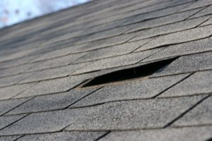 Roofing Contractor Services Replacing A Roof Shingle